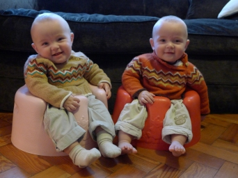 Enjoying a new view point in their bumbo seats