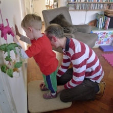 Using a wobble board to help improve his balance