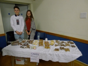 Mat and Ayesha running the cake stall